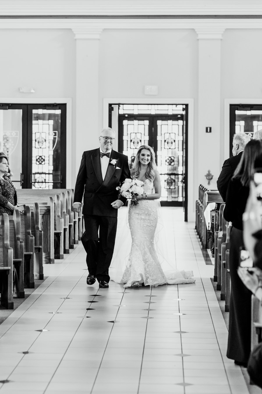 bride and dad walking down aisle
